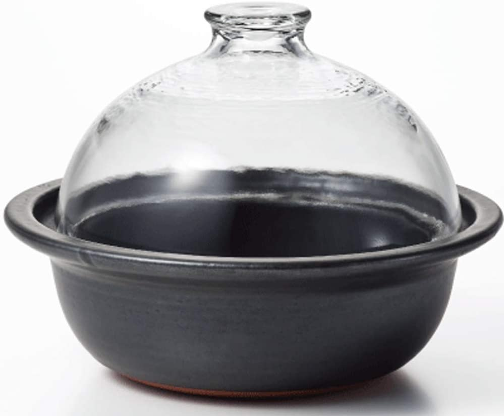 Japanese Donabe Smoke Cooker with wood chips and a wire mesh