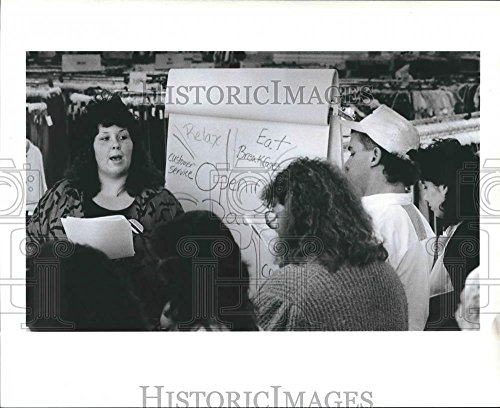 1990 Press Photo Dawn Hauck Helps Prepare T J  Maxx Employees For Opening