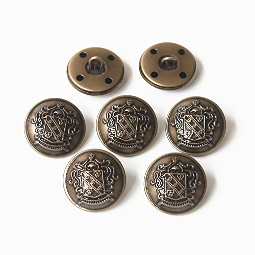 Antique brass metal buttons with a vintage touch.