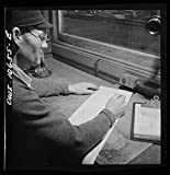 Vintography Reproduced Photo of Chicago, Illinois. As Each car goes by his Window at an Illinois Central Railroad Yard, The Engine Foreman Checks it Against his Switch List 1942 Delano C Jack 16a