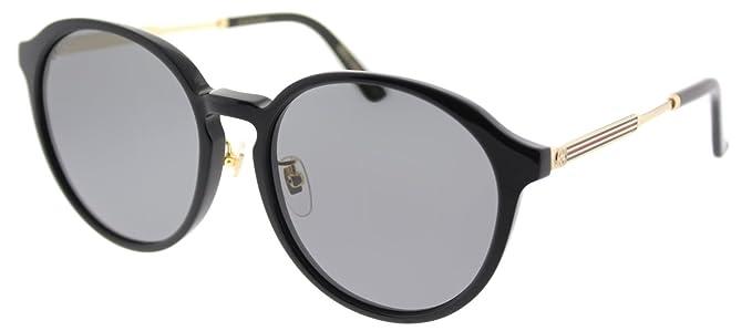 100aeaecd99a1 Amazon.com  Gucci GG 0205SK 001 Black Plastic Fashion Sunglasses ...