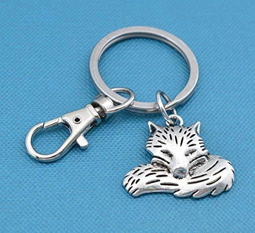 Sleeping Fox keychain with silver toned fox on stainless steel key ring and snap hook. Fox keychain. Fox gifts. Silver Fox. Fox jewelry.