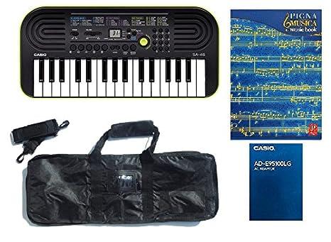 Casio SA 46 teclado con 32 teclas Mini, fuente de alimentación original, bolso con bandolera, Cuaderno Música A4: Amazon.es: Instrumentos musicales