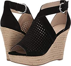 The Marc Fisher™ Haldya is the icing on the cake of your look! Leather upper. Adjustable buckle at ankle. Open-toe design with perforated detail on vamp. Synthetic lining. Lightly padded footbed. Jute wrapped platform and wedge heel. Imported...
