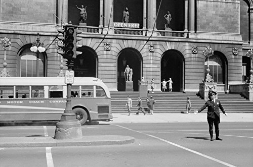 Chicago Art Institute 1940 Na Police Officer Directing Traffic Outside The Art Institute Of Chicago In Chicago Illinois Photographed By John Vachon July 1940 Poster Print by (18 x 24)
