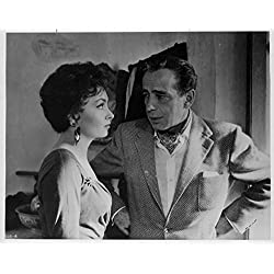 Humphrey Bogart and Gina Lollobrigida in a movie scene. - Poster Art Print