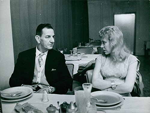 vintage-photo-of-gavin-de-becker-and-leslie-having-a-conversation-while-in-a-dining-table-photo-take