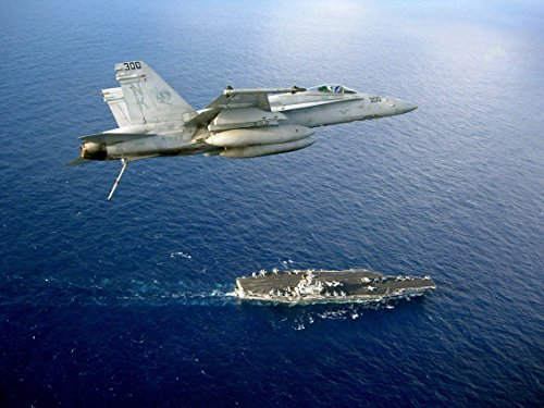 An F/A-18C Hornet assigned to the Stingers of Strike Fighter Squadron (VFA) 113 flies above the N