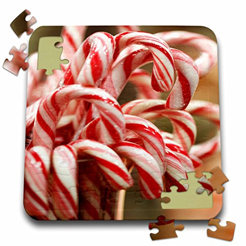 3dRose Taiche - Photography - Christmas Candy Cane - Red and white Striped Christmas Candy Cane In A Jar - 10x10 Inch Puzzle (pzl_181596_2)