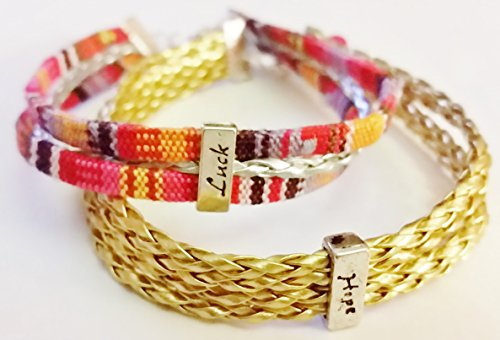 "Bracelet set (2). Sizes 8 & 8 ¾"". Gold braid & tribal fabric material on silver tone closures. (Closure Material)"