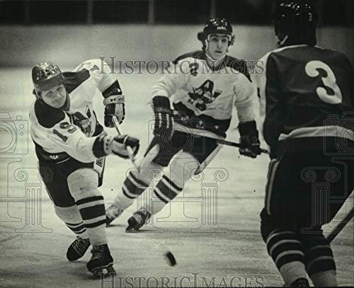 - Vintage Photos 1982 Press Photo Milwaukee Admirals' Sheldon Currie Hits a Slapshot During Game.