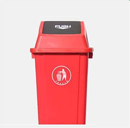Four Big Isolated Plastic Trash Bin Are Located On A Green Gras Stock Photo