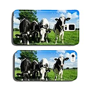 Four cattle in a summer pasture looking curiously cell phone cover case Samsung S5