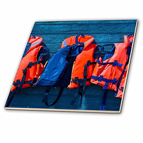 3dRose Alexis Photography - Objects - Water safety goes first. Orange life saving jackets on a blue wall - 8 Inch Glass Tile (ct_267156_7) by 3dRose