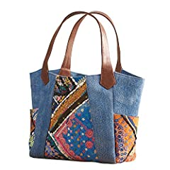 Traditional Banjara textiles are famed for their distinctive embroidery, brilliant dyes, and signature embellishments. This pretty purse features beautiful Banjara work framed by denim-hued cotton on a bag made for travel, shopping, and daily...