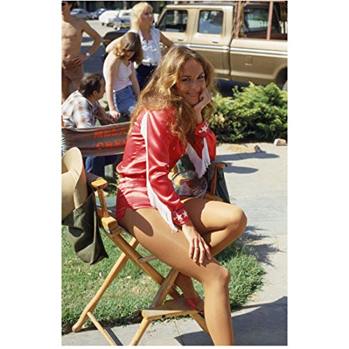 Catherine Bach 8 inch x 10 inch Photo The Dukes of Hazzard Thunderbolf and Lightfoot African Skies Seated in Red/White Shorts Outfit Pose 1 -