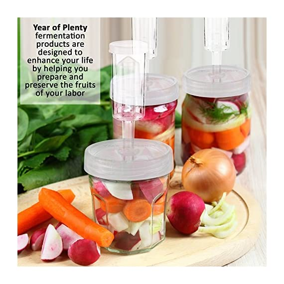 Year of Plenty Fermentation Lids for Making Sauerkraut in Wide Mouth Mason Jars, Set of 4, Includes Instructions and Recipe ... 5 Set includes 4 air locks, 4 sturdy clear screw-on lids for wide mouth mason jars, 4 silicone gaskets, 4 grommets, 1 (2-sided) instruction/recipe sheet. All components are BPA-Free. Use the sturdy, handsome storage case to improve organization in your kitchen. Makes an excellent gift for the fermentation expert in your life. Begin making tasty, healthy sauerkraut, kimchi, ginger carrots, pickles and other fermented foods with safety and ease