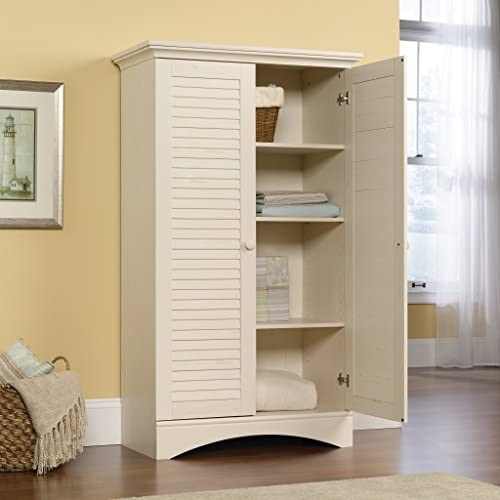 """51ICej7pYoL. AC Sauder Harbor View Storage Cabinet, Antiqued White finish, L: 35.43"""" x W: 16.73"""" x H: 61.02"""",    With this storage cabinet from the Harbor View collection, you can add extra storage space to any room in your home. Behind the two louver detailed doors is hidden storage that includes a full upper shelf and four adjustable shelves so you can store clothes, towels, blankets and more! Finished in a beautiful Antiqued Paint and detail with solid wood knobs, this stylish storage cabinet will keep you organized with ease."""