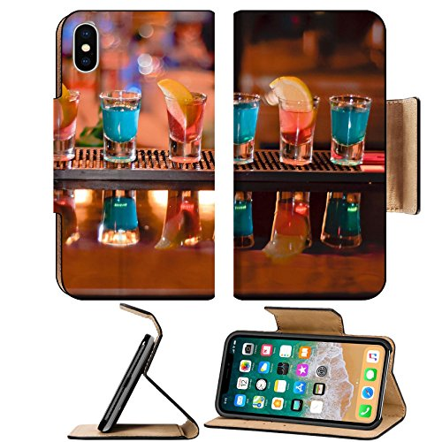 Luxlady Premium Apple iPhone X Flip Pu Leather Wallet Case IMAGE ID 7989476 Row of shots on the bar tequila and blue curacao