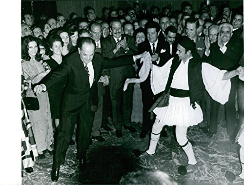 Vintage photo of George Papadopoulos dancing the Sirtaki with one evzone of the Royal Guard. ()