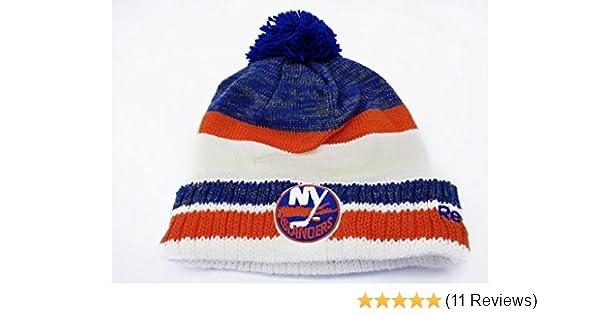 21f01700028 Amazon.com   Reebok NHL Center Ice Men s Cuffed Knit Beanie Hat with Pom  (One Size