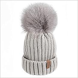 e74bc89e0bf Amazon.com  FURTALK Winter Knit Hat Real Raccoon Fur Pom Pom Womens Girls  Warm Knit Beanie Hat (Grey (Grey Fox Fur Pompom)) (0612677851832)  Books