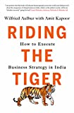 img - for Riding the Tiger: How to Execute Business Strategy in India book / textbook / text book