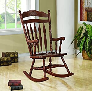 coaster rocking chair with carved detail in medium brown finish