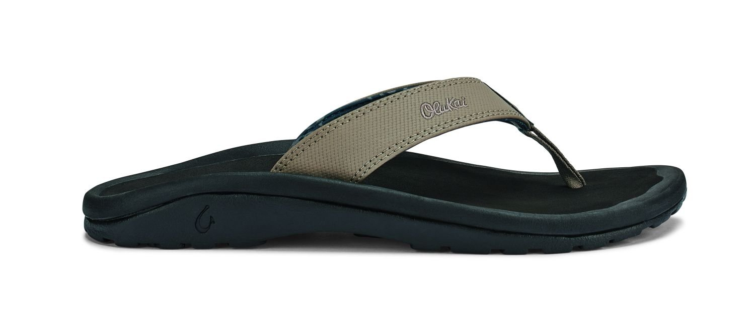 OLUKAI The classic 'Ohana is your go-to choice for simple everyday style. Soft nylon toe post webbing, laser-etched logo, and embroidered detail. Weather-resistant and floats. by OLUKAI