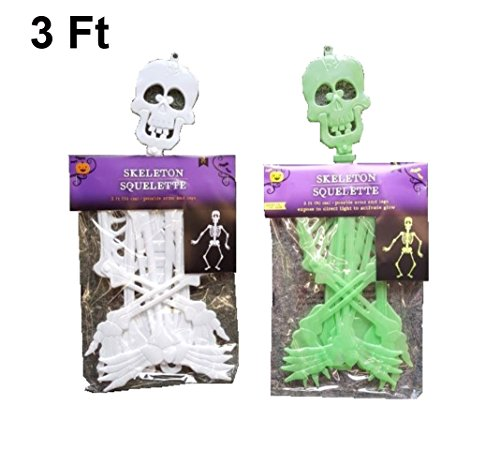 Two Plastic hanging skeletons, 1 glow-in-the-dark, 1 white