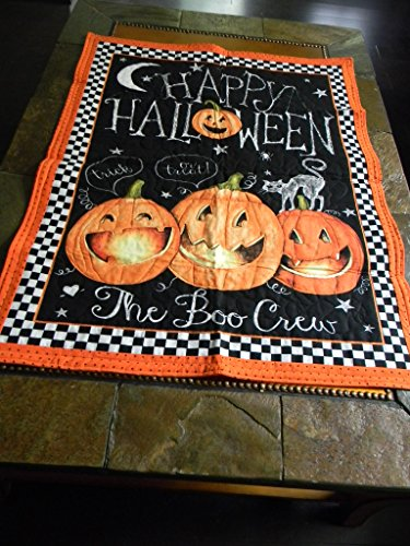 The Boo Crew says Happy Halloween on this darling quilted wall hanging.
