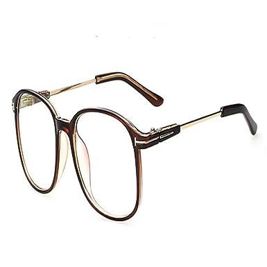 16c4fafd360 Amazon.com  Vintage Retro Round Glasses Frame For Women Nerd Eyeglasses  Frames Men Clear Fake Glasses Eyewear Oculos Optical Frame (Brown)  Clothing