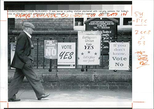 (Vintage photo of A voter leaves a Dublin polling station.)
