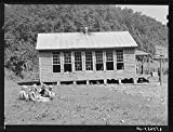 Children eating lunch during noon hour by one-room rural mountain school. Breathitt County, Kentucky