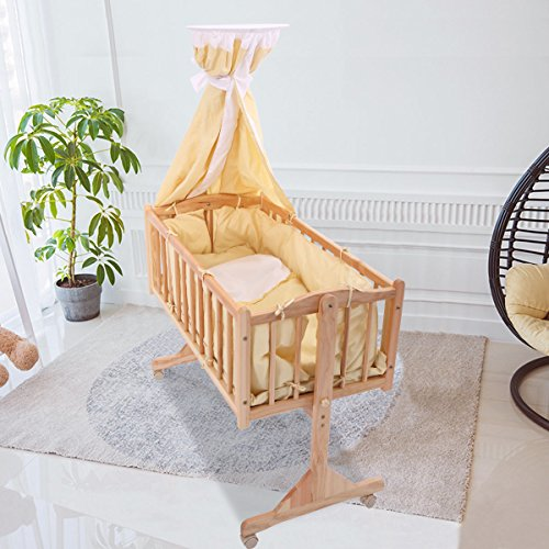 Review JAXPETY Wood Rocking Cradle,Gliding Bassinet with Canopy Bedding- Yellow