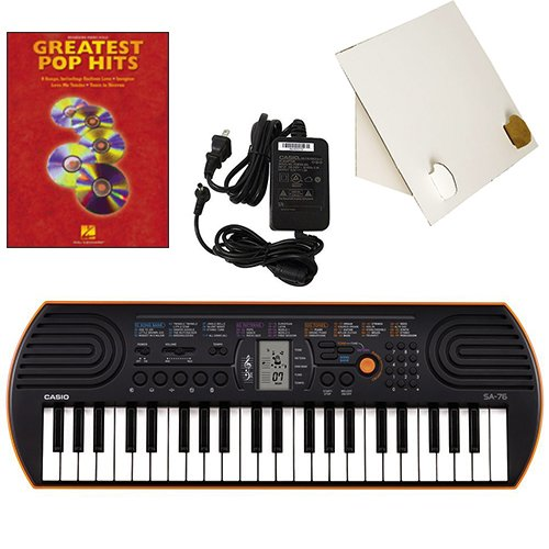Casio SA-76 44 Key Mini Keyboard Deluxe Bundle Includes Bonus Casio AC Adapter, Desktop Music Stand & Greatest Pop Hits Beginning Piano Solo Songbook by Casio