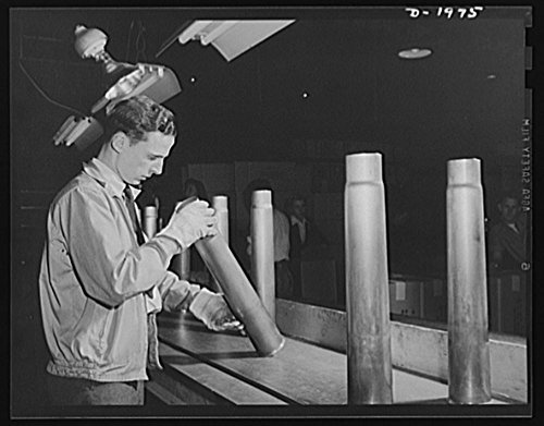 1942 Photo Three-inch A.A. cartridge cases. Antiaircraft cartridge case produced in a large Midwest metal working plant go through the Army ordnance inspection before they are accepted Location: Ohio