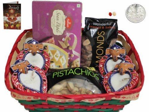 Bhaidooj Diwali Gift Hamper Combo- Haldiram Soan Papdi, Almonds, Pistachio and 4 Wax Filled Diyas in a Beautiful Basket