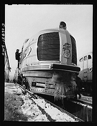(1942 Photo Chicago, Illinois. One of the Chicago and Northwestern Railroad streamliner diesel electric trains. These trains are operated jointly with the Union Pacific Railroad to the west coast Location: Chicago, Cook County, Illinois)