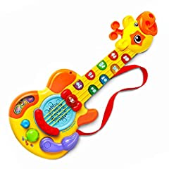 Rock and learn with the Zoo Jamz Guitar by VTech. Join the animal band and play along with the silly giraffe. The eight light-up buttons and strings allow your little musician to jam to the included music or make their own. The light-up butto...