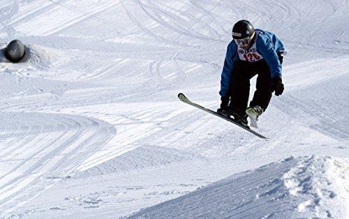 Gaven Hollingsworth, 13, jumps over a mogul at the Hillberg Ski Area terrain park during a free styl (Ski Terrain Park)