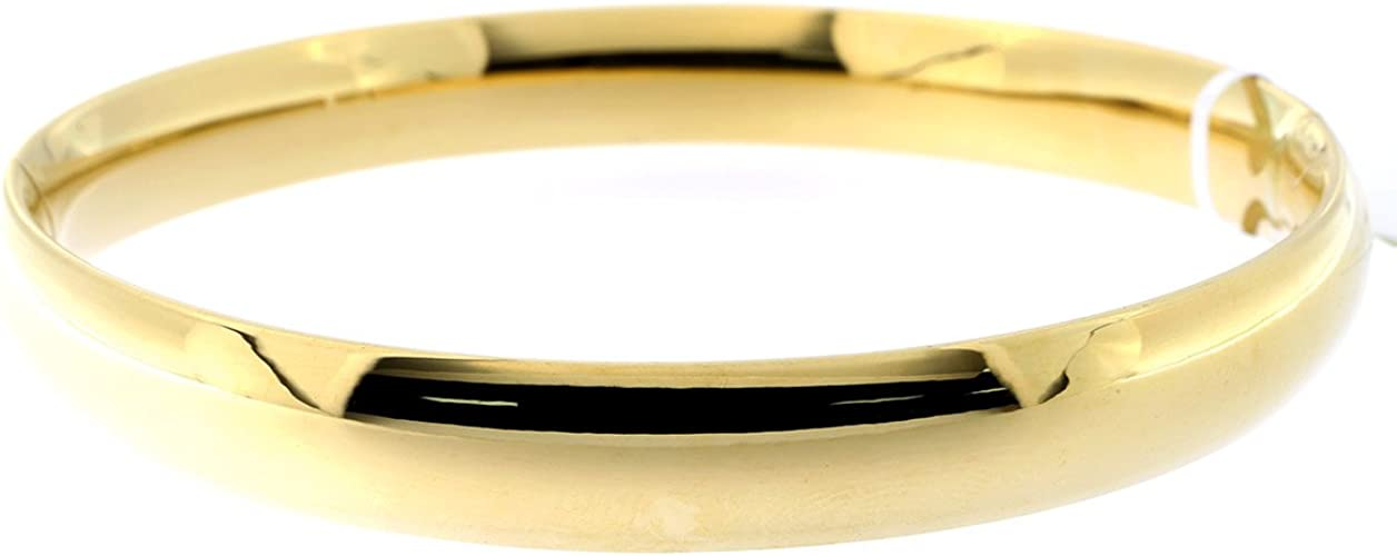 Brand New Pure 14K Gold Bangle bracelet 7 inches long Very nice fastener