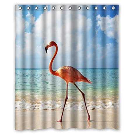 Cute Flamingo Walking On The Beach