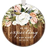 "We're Expecting A Baby In 2019, Christmas Ornament Pregnancy Announcement Pregnant Reveal Gift Rustic Modern Farmhouse Floral Present Pretty 3"" Flat Circle Porcelain w/White Ribbon & Free Gift Box"
