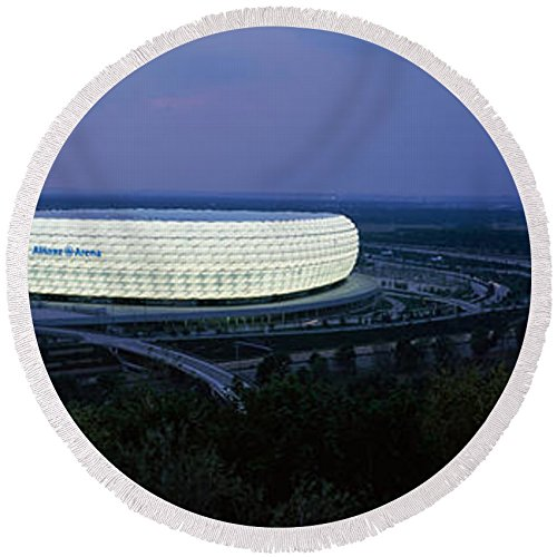 Pixels Round Beach Towel With Tassels featuring ''Soccer Stadium Lit Up At Nigh, Allianz'' by Pixels by Pixels