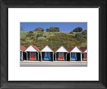 Con marco de diseño de casetas de playa, Bournemouth Promenade, Dorset, Inglaterra,