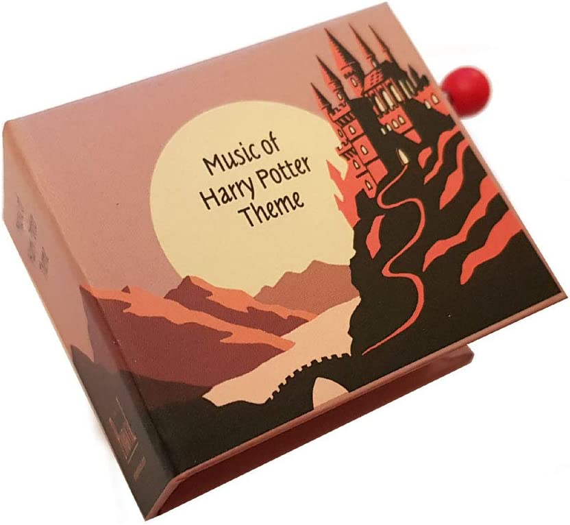 Caja de música / caja musical de manivela de cartón en forma de libro - El tema de Harry Potter - Hedwigs theme - Harry Potter y la piedra filosofal (John Williams): Amazon.es: Bebé