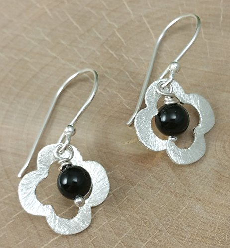a-pair-of-modern-silver-flower-with-black-onyx-gemstone-dangle-earrings-in-a-brushed-finish
