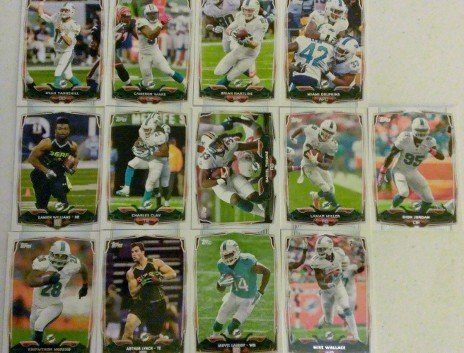 2014 Topps Football Miami Dolphins Team Set In a Protective Case - 13 cards including Ryan Tannehill, Dion Jordan, Cameron Wake, Daniel Thomas, Brian Hartline, Charles Clay, Arthur Lynch RC, Lamar Miller, Knowshon Moreno, Mike Wallace, Jarvis Landry RC, Damien Williams RC, and a Team Card.