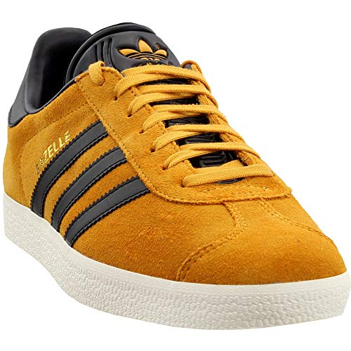 - adidas Originals Gazelle Sneaker,Tactile Yellow/Black/Metallic Gold,7 Medium US